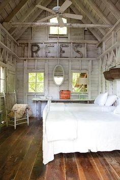 White, rustic cabin bedroom - Soulful Southern Cabins | Garden and Gun