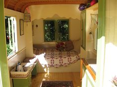 I love this nook/day bed.  It is inside a caravan.  I would love to have a little cottage like this that I could escape to.