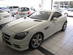 2012 Mercedes Benz SLK200 AMG Sports - only 16 368kms for R 399 900 - one previous owner - Roadster - 1.6L Engine with 135kW output - Mirror Package (folding in) - Memory Package - Automatic Child seat Recognition - 4 way lumber support - AMG Floor Mats - Leather seats - Direct steer system - Parking Assist PARKTRONIC - Led Daytime running lights - Front seat left electrically adjustable with memory switch - AIRGUIDE - Rain sensor - AIRSCARF - AMG Speed shift -Karen Gouws: 084 5406178