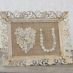 I need to do this with all my and my Gramma's old buttons - I still have them in the original jars. Of course you can buy the buttons at the craft or sewing store. Burlap background, shabby or thrift frame.
