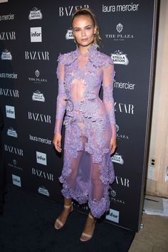 Natasha Poly - Poly's sheer lavender look stood out in a sea of black.