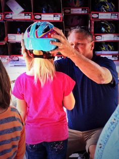The Intermountain LiVeWell team fave away free helmets to kids at the open house for the new North Cache Valley Clinic