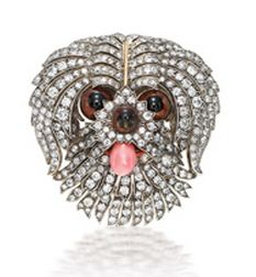 CONCH PEARL AND DIAMOND BROOCH  The old-cut diamond set brooch designed as a puppy's head, accentuated by enamel eyes and a protruding tongue set with an oscillating conch pearl. Diamonds altogether weighing approximately 7.20 carats. Mounted in 18 karat white and yellow gold.