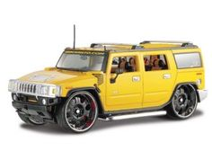 This Hummer H2 SUV Diecast Model Car Kit is Yellow and features working steering, wheels and also opening bonnet with engine, boot, doors. This model kit made by Maisto requires assembly and is 1:18 scale (approx. 25cm / 9.8in long). Screw driver supplied, no glue required - build your own blinged-out Hummer. Picture shows assembled kit....