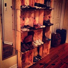 Used old wine crates to make a shoe shelf!