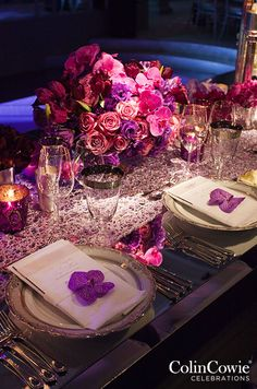 Purple Wedding Inspiration: Pink and purple roses and orchids look incredibly sexy within these lush centerpieces. http://www.colincowieweddings.com/flowers-and-decor/purple-wedding-flowers