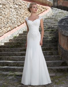 Sincerity wedding dress style 3903 is shown in our store in a size 14 and in Ivory.Venice lace cap sleeves draw the eye to the Queen Anne neckline and lace covered bodice of this slim A-line gown. A chiffon ruched waistband accents the natural waist of this classic silhouette.