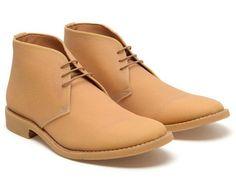 a bit pricey for rubber. Martin Margiela Rubber Desert Boots. $741.