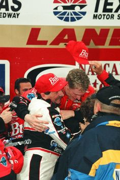 April 2, 2000: Dale Earnhardt Jr. celebrating with his legendary father, Dale Earnhardt, in Victory Lane after winning the first NASCAR Winston Cup Series race of his career.