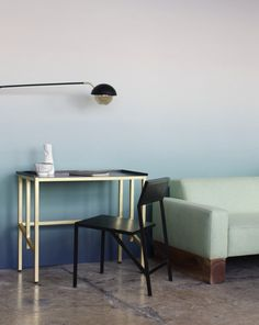 A brass-and-steel desk by Saw.  Wanted Design in Industry City   Lonny