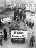 Men Atop Beer Delivery Truck Hoist Cases of Beer Triumphantly While Man Repeal of Prohibition