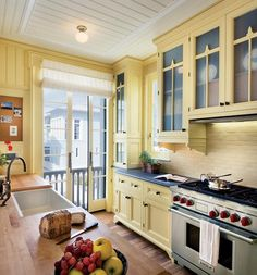 Love this vintage look - great beadboard ceiling The cabinets are really charming- they go all the way to the ceiling and their details are great. I like glass pocket doors- they don't eat up floor space. It is a crisply elegant country/victorian kitchen.