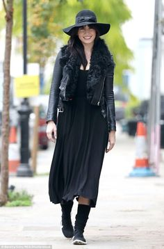 Happy feet: Smiling Daisy Lowe stepped out in an all-black ensemble and matching hat on Mo...