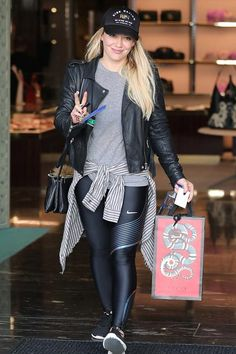 Hilary Duff wearing Celine Trio Bag, Rise Nation We Climb We Rise Hat and Nike Power Speed Running Tights