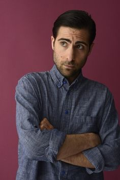 I freakin' love the blue buttons on and the material of Jason Schwartzman's chambray shirt here