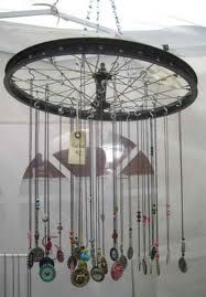 Bicycle wheel or other type of wheel to display jewelry or ornaments. Good window display for Peddler's Jamboree window.
