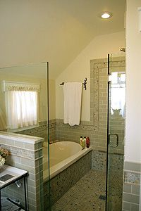 I  love the idea of the bathtub and shower being sectioned off together like that in a master bedroom.