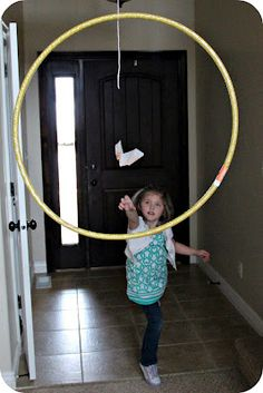 Flight school w/paper airplanes!  Kids make airplanes and try to fly them into the hoops to earn points.  Looks fun