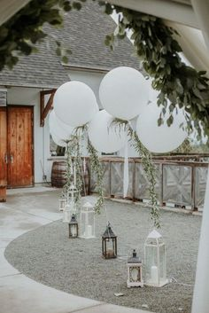 Greenery Wedding Ideas That Are Actually Gorgeous--Balloon Wedding Decor with Greenery, Whimsical Greenery Wedding with Balloons, spring weddings, diy wedding decorations, Wedding Balloon Decorations, Wedding Decorations On A Budget, Wedding Lanterns, Wedding Balloons, Wedding Centerpieces, Wedding Backdrops, Wedding Entrance Decoration, Wedding Entrance Table, Wedding Arches