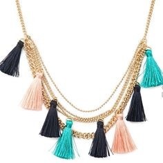 Forever 21 layered tassel necklace Brand new in package. Faux gold layered chains with 8 fringe tassels in black pink and mint. Cute statement necklace. Forever 21 Jewelry Necklaces