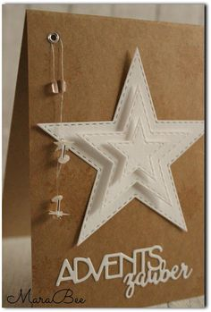 handmade advent card from MaraBee´s Welt ... kraft with white die cuts ... great use of layered star cuts with embossed stitch lines as borders ...