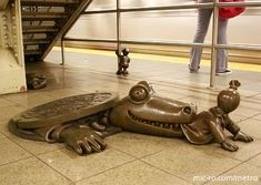 """Over 100 whimsical bronze sculptures inhabit the NYC subway. """"Life Underground"""" by Tom Otterness is located in the Street and Avenue station are over 100 little cast-bronze sculptures depicting life in NYC. Bronze Sculpture, Sculpture Art, Sculptures, Nyc Subway, Subway Art, Tom Otterness, Pavement Art, Modern Words, A New York Minute"""
