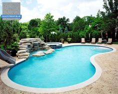 This pool's curved shape keeps the water moving around the Hydrazzo Gulfstream Blue finish. Downes Swimming Pool Company of Arlington Heights, IL. #swimmingpool #pool