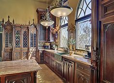 Gothic kitchen design featured with elements of stone, arches reminiscent of cathedrals during the Middle Ages and stained glass. To get a complete gothic kitchen design, you should select ornate furniture for an eat-in kitchen made from rustic wood. Gothic House, Victorian Gothic, Victorian Homes, Gothic Mansion, Gothic Castle, Victorian Interiors, Medieval Castle, Haunted Mansion, Gothic Lolita
