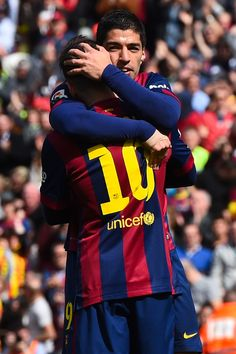 Lionel Messi of FC Barcelona celebrates with his teammate Luis Suarez of FC Barcelona after scoring his team's fourth goal during the La Liga match between FC Barcelona and Rayo Vallecano de Madrid at Camp Nou on March 8, 2015 in Barcelona, Catalonia.