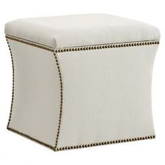 """Nailhead-trimmed storage ottoman. Handmade in the USA with solid pine wood.     Product: Storage ottoman    Construction Material: Solid pine, polyurethane and polyester fill foam    Color: Talc   Features:   Handmade in the USA    Versatile function for storage, footrest, or tabletop    Curvaceous silhouette and elegant nailhead trim   Dimensions: 17"""" H x 19"""" W x 19"""" D"""