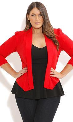 #NaturalSize Black peplum blouse, red blazer, chestlength wavy brown hair, pink lips, dark pants