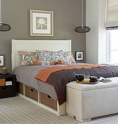 don't love the colors, but I like the accent wall, hanging lights (could also be hanging plants?), little pics by the nightstands and pic above the bed.