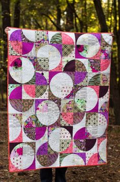 Sing All You Want: Drunkard's Path Quilt. Something like this with all my gray and black stash?