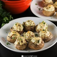 Classic Stuffed Mushrooms with a creamy cheesy filling including garlic and parmesan cheese get baked until the tops are lightly golden and delicious! From: http://centercutcook.com/stuffed-mushrooms/