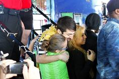 Mitch Grassi hugging Esther and Kirstie. Avi and Kevin totally ignoring the cute moment behind them.