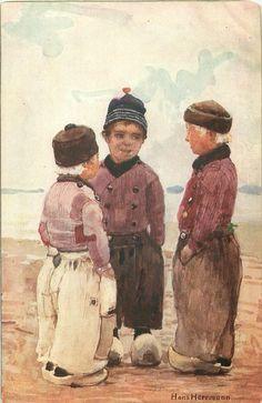 SERIES HOLLANDKINDER VOLENDAM three Dutch boys stand with hands in pockets, on sea-shoreHans Herrmann