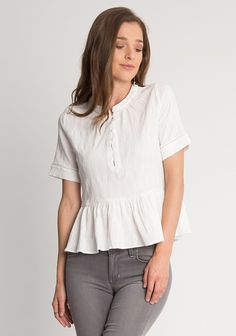 White peplum blouse with round neckline, button up chest, crochet insert and short sleeves. Unlined.  100% Cotton , Imported , 37