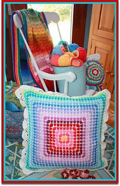 Mosaic Granny Pillow by the garden bell, via Flickr