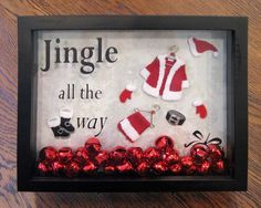Cut out the santa clothes from felt add a few small ornaments into a shadow box with a vinyl quote