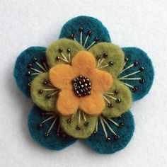 "Folksy :: Buy ""Layered felt brooch"" - Fabric Crafts A beautiful, feminine brooch made from 3 layers of scrumptiously thick wool felt.Embroidered and beaded with metallic rainbow seed beads, and firmly attached to a 1 Brooches Handmade, Handmade Felt, Handmade Crafts, Handmade Flowers, Handmade Jewelry, Felt Diy, Felt Crafts, Fabric Crafts, Sewing Crafts"