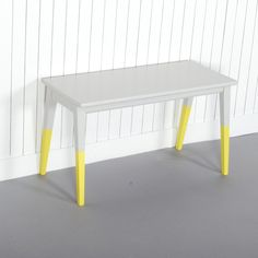 Nicholson - £60.00 - The bold yellow finish of the angular tapered legs creates a geometric aesthetic that is contrasted against the cool grey. This small and simple bench/side table adds a subtle yet striking element of colour and timeless design. Product specification: W 69 x D 27 x H 39 cm4kg