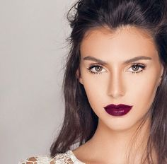 """Let the lips do all the talking by keeping your eyes neutral. Check out NYX Cosmetics Extra Creamy Round Lipstick in """"Black Cherry,"""" to find your perfect berry hue."""