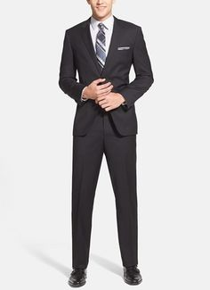 Dress to impress in this Hugo Boss trim fit black wool suit.