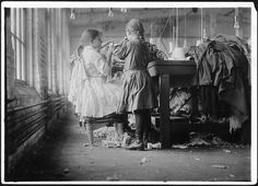 Two of the tiny workers, a raveler and a looper in London Hosiery Mills. London, Tenn, December 1910 by The U.S. National Archives