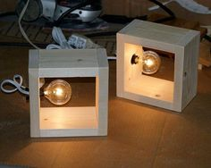 This simple modern hand made wood box lamp can be a wall sconce or a table top accent lamp. Within a wood square box is a candelabra style night
