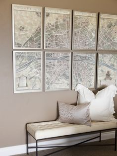 decorpad - Alice Lane Home  Vintage, silver framed artwork map of Paris. Taupe wall color, cream leather and iron bench with gray sequined pillow and white cotton pillow.