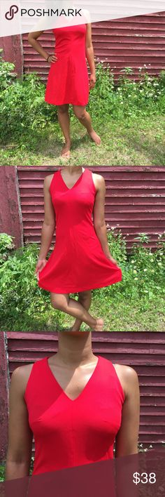 Vintage Fit & Flare Dress  Vintage Carol Craig dress. Red fit and flare with v-neck. No size/material tag, fits small. Modeled on size 4/6. Likely 100% polyester. Zips down back with hook and eye closure. In great vintage condition with small spots on back Carol Craig  Dresses