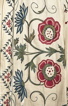 Detail embroidery, robe à l'Anglaise, England, c. 1775. Chain-stitch floral silk embroidery in red, green and blue on white cotton twill, linen lining.