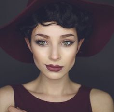 Short curls and a flopy hat!