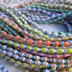 DIY: Paper Beads ---- Also: http://paperbeads.org/how-to-make-paper-beads-w-a-metal-roller/. Different shapes at: http://www.tappi.org/paperu/images/beads5.gif.